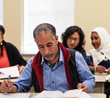 A classroom of immigrants at school